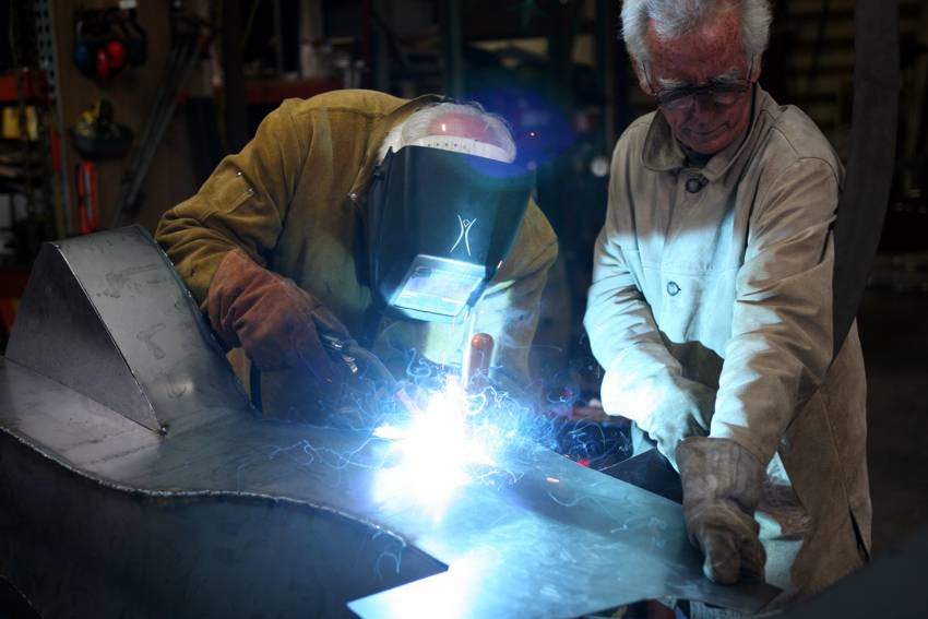 Bob Stokes and welder Gray Lucier construct the Avenue of the People